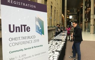 Registration table at the conference in 2019.